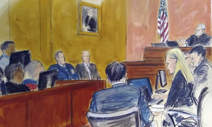"""Judge Brian Cogan upper right, gives instructions to jurors in the trial of Joaquin """"El Chapo"""" Guzman in New York. On  Feb. 20, 2019, El Chapo's lawyers raised concerns of potential juror misconduct and said they were reviewing """"all available options"""" after a juror at the notorious Mexican drug lord's trial told a news website that several jurors looked at media coverage of the case against a judge's orders. (Elizabeth Williams via AP)"""