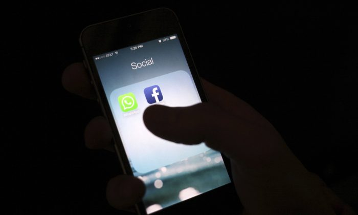 """The Facebook app icon on an iPhone in N.Y., on Feb. 19, 2014. The Wall Street Journal is reporting that several phone apps are sending sensitive user data to Facebook, including health information, without users' consent. The report says an analytics tool called """"App Events"""" allows app developers to record user activity and report it back to Facebook, even if the user isn't on Facebook. (Karly Domb Sadof/AP)"""