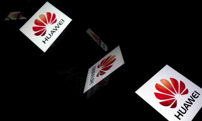 This illustration picture shows the Chinese multinational telecommunications manufacturer Huawei logo displayed on a tablet in Paris on February 18, 2019. (LIONEL BONAVENTURE/AFP/Getty Images)