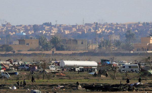 Islamic state members walk in the last besieged neighborhood