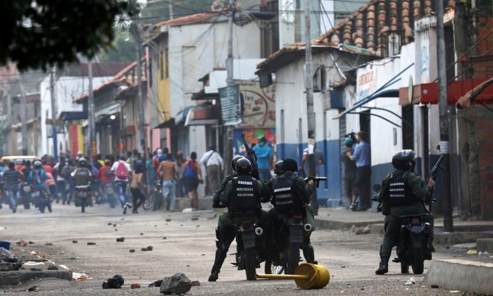 Venezuelan activists clash with security forces in Urena, Venezuela, on Feb. 23, 2019. (Andres Martinez Casares/Reuters)