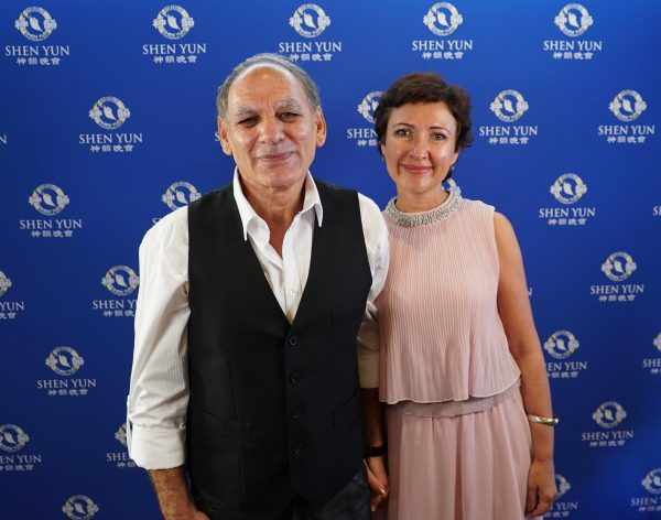 Private practice accountant George Fiorentino (L) and mechanical engineer Elen Kalashnineikova (R) saw Shen Yun at Perth's Regal Theater in Western Australia, on Feb. 23, 2019. (Victor Bernal/NTD)