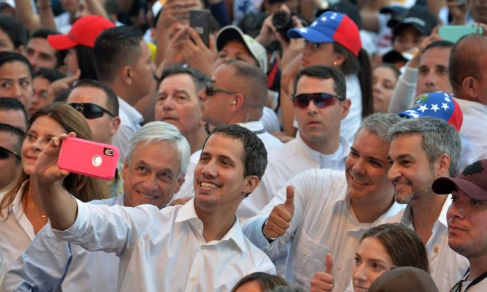 "Venezuela's opposition leader Juan Guaido (C) takes a selfie his wife Fabiana Rosales (R, foreground), Chilean President Sebastian Pinera (next to him at left), Colombian President Ivan Duque (2-R, giving thumb up), and Paraguayan President Mario Abdo Benitez (R) during the ""Venezuela Aid Live"" concert in Cucuta, Colombia, on Feb. 22, 2019. (Luis Robayo/AFP/Getty Images)"