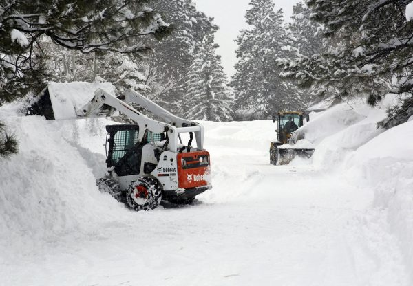 Snow-throwers and front-end loaders are move snow