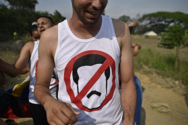 A man wears an anti-Maduro tshirt