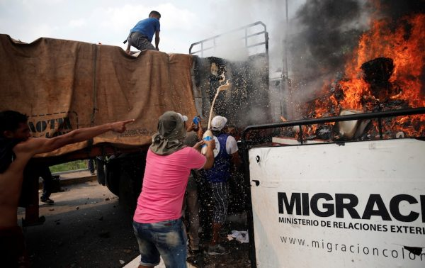 humanitarian aid from a truck set on fire before reaching Venezuela