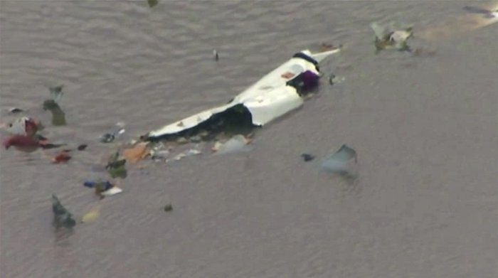 The scene of a cargo plane crash on Feb. 23, 2019 in Trinity Bay, just north of Galveston Bay and the Gulf of Mexico in Texas. (KRIV FOX 26 via AP)