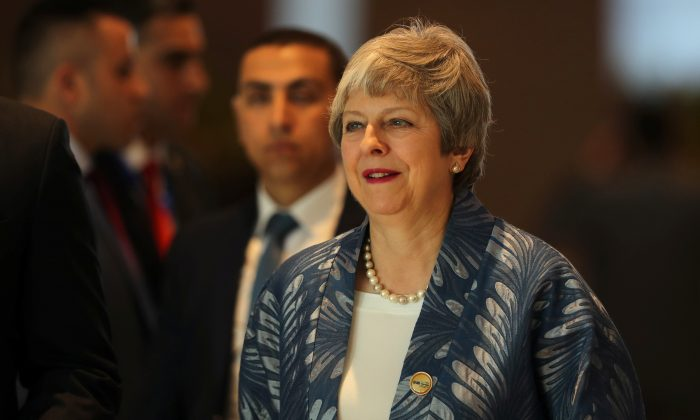 Britain's Prime Minister Theresa May arrives to attend a summit in Sharm el-Sheikh, Egypt, on Feb. 24, 2019. (Mohamed Abd El Ghany/Reuters)