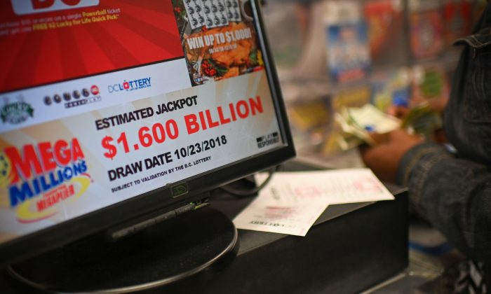 A woman buys Mega Millions tickets hours before the draw of the $1.6 billion jackpot, at a liquor store in Downtown Wash. DC, on Oct. 23, 2018. (Eric Baradat/AFP/Getty Images)