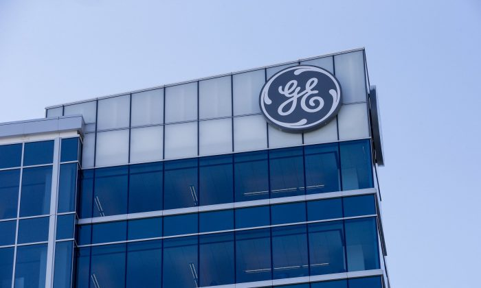 The General Electric logo is displayed at the top of the company's Global Operations Center in the Banks development of downtown Cincinnati, on Jan. 16, 2018. (John Minchillo/AP)
