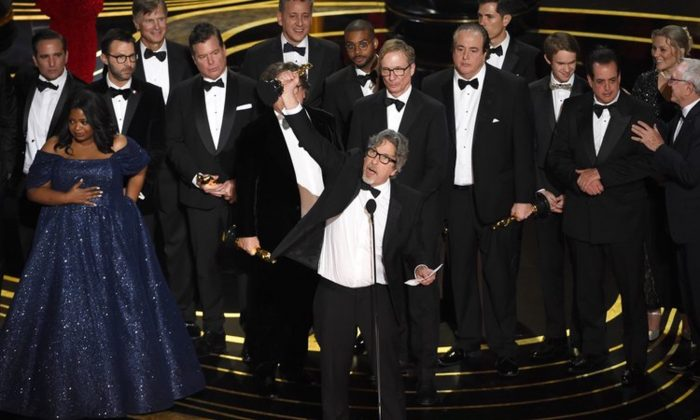 "Peter Farrelly, center, and the cast and crew of ""Green Book"" accept the award for best picture at the Oscars at the Dolby Theatre in Los Angeles on Feb. 24, 2019. (Chris Pizzello/Invision/AP)"