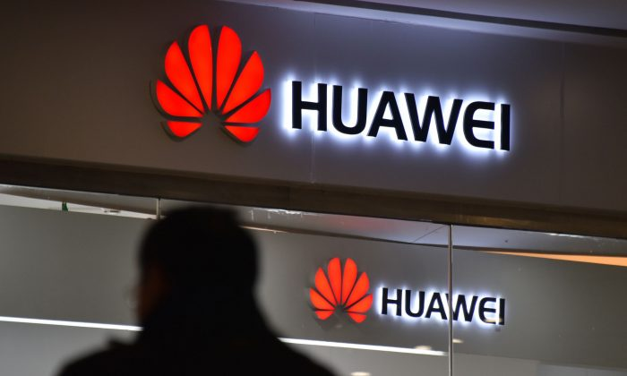 A man walks past a Huawei store in Beijing on Dec. 10, 2018. (GREG BAKER/AFP/Getty Images)