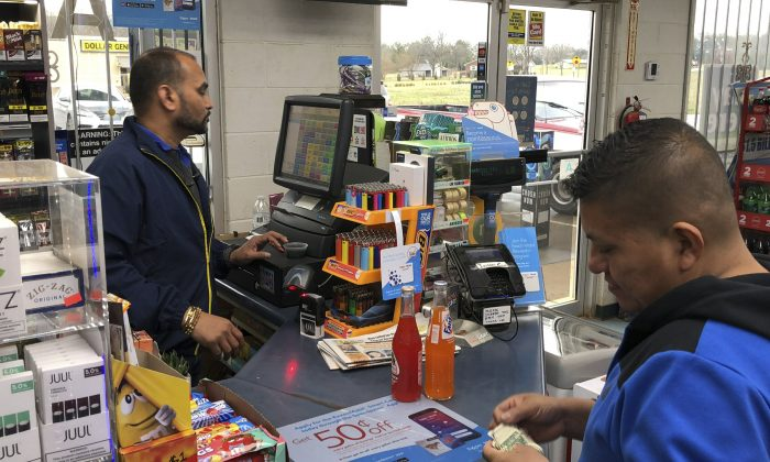 Jee Patel checks out a customer at the KC Mart in Simpsonville, S.C., on Feb. 19, 2019. The store sold the only Mega Millions ticket to win the $1.5 billion jackpot in October 2018. The ticket has not been claimed. (Jeffrey Collins/AP)