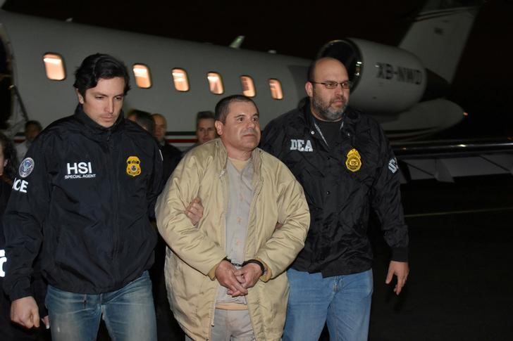 "Mexico's top drug lord Joaquin ""El Chapo"" Guzman is escorted as he arrives at Long Island MacArthur airport in New York"