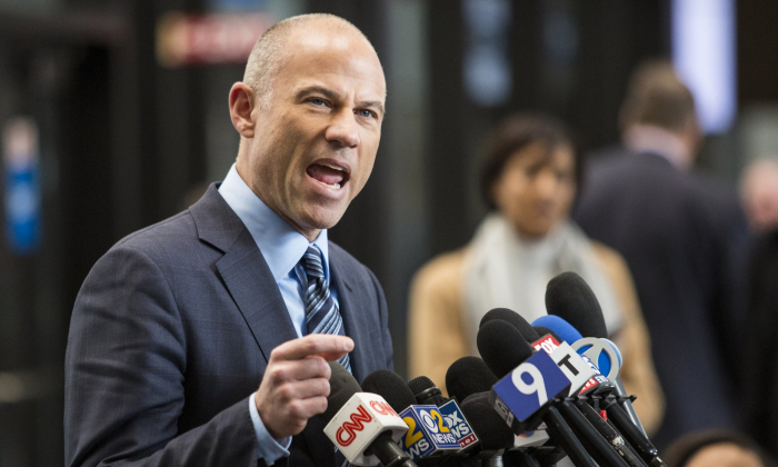 Attorney Michael Avenatti, who is representing an alleged R. Kelly victim, speaks to reporters at the Leighton Criminal Courthouse in Chicago after the R&B singer entered a not guilty plea to all 10 counts of aggravated criminal sexual abuse, on Feb. 25, 2019. (Ashlee Rezin/Chicago Sun-Times via AP)