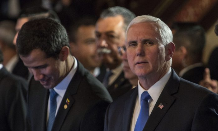 Vice President Mike Pence and Juan Guaido, recognized by Washington and others as Venezuela's interim president, take part in a meeting with foreign ministers of the Lima Group at Colombia's Foreign Affairs Ministry in Bogota Feb. 25, 2019. (Diana Sanchez/AFP/Getty Images)