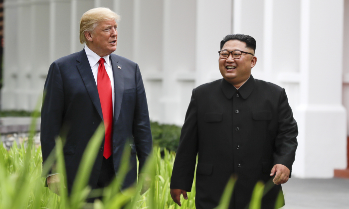 President Donald Trump and North Korea leader Kim Jong Un walk from their lunch at the Capella resort on Sentosa Island in Singapore on June 12, 2018. (Evan Vucci/AP Photo)