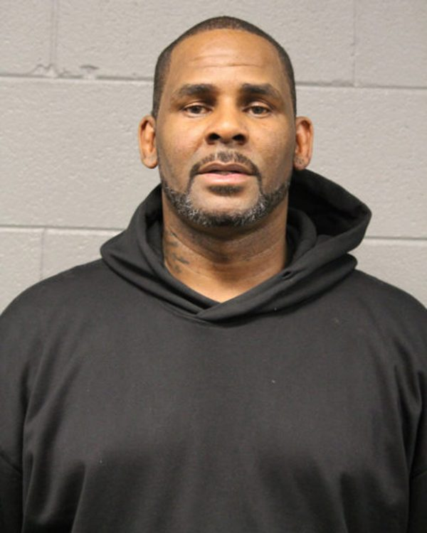 R&B singer R. Kelly is photographed during booking at a police station