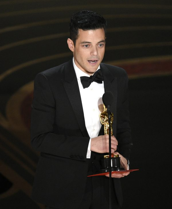 Rami Malek accepts the award for best performance