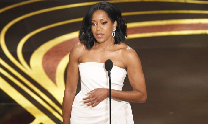 """Regina King accepts the award for best performance by an actress in a supporting role for """"If Beale Street Could Talk"""" at the Oscars on Feb. 24, 2019, at the Dolby Theatre in Los Angeles. (Chris Pizzello/Invision/AP)"""