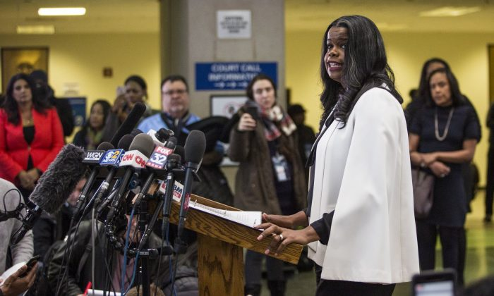 Cook County State's Attorney Kim Foxx speaks to reporters at the Leighton Criminal Courthouse after R. Kelly was ordered held on a $1 million bond in Chicago ,on Feb. 23, 2019 . (Ashlee Rezin/Chicago Sun-Times via AP)