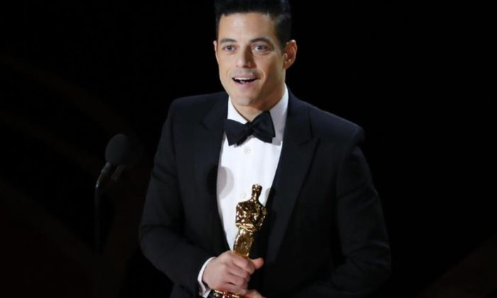 "Rami Malek accepts the Best Actor award for his role in ""Bohemian Rhapsody."" (Mike Blake/Reuters)"