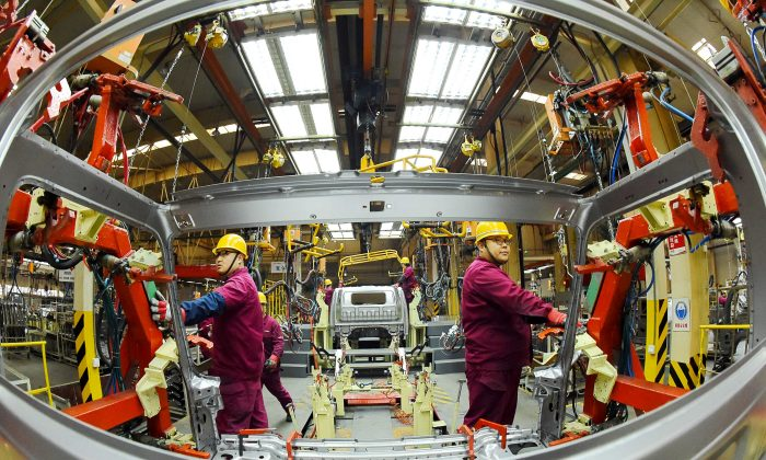 Employees work on a production line manufacturing light trucks at a JAC Motors plant in Weifang, Shandong Province, China on Nov. 30, 2018. (Reuters)