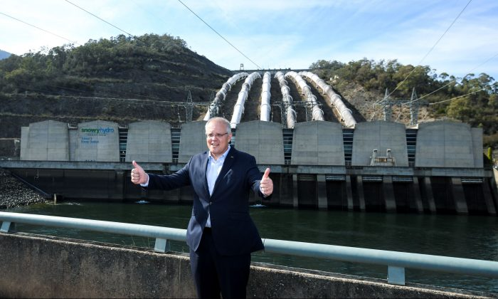 Australia's Prime Minister Scott Morrison poses for photographs in front of the Tumut 3 power station at the Snowy Hydro Scheme in Talbingo, Australia, on Feb. 26, 2019. (AAP Image/Lukas Coch)