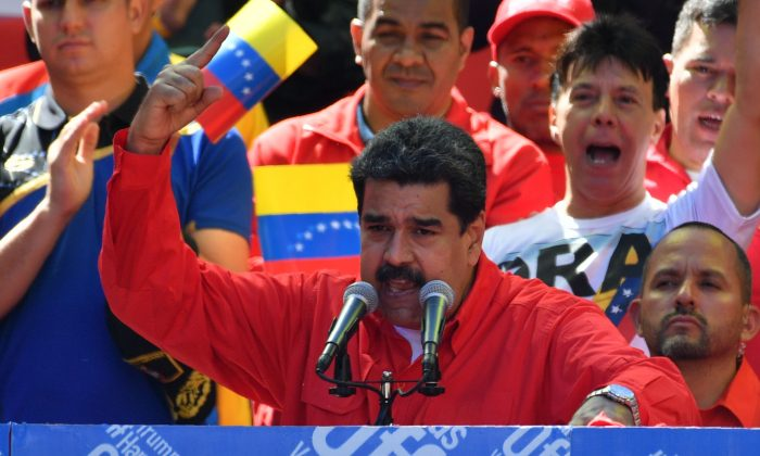 Venezuelan strongman Nicolas Maduro speaks during a pro-government march in Caracas, on Feb. 23, 2019. (Yuri Cortez/AFP/Getty Images)