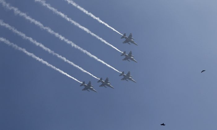 In this file image, Indian Air Force Mirage 2000 fighters fly in formation on Jan. 23, 2012. (AP Photo/Saurabh Das, File)