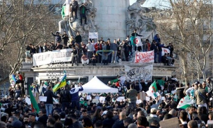 Demonstrators gather around the Monument to the Republic during a protest against President Abdelaziz Bouteflika seeking a fifth term in a presidential election set for April 18, in Paris, France, Feb. 24, 2019. (Charles Platiau/Reuters)