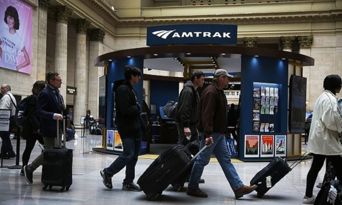 Passengers walk to their trains at Union station where Amtrak's California Zephyr makes a daily 2,438 miles run to Emeryville/San Francisco that takes roughly 52 hours in Chicago, Illinois, on March 23, 2017. (Joe Raedle/Getty Images)