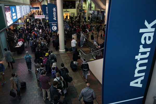 Passengers wait to board an Amtrak train at Union Station