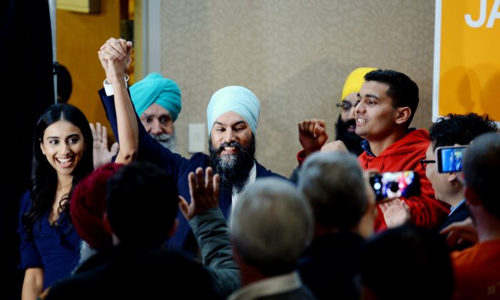 NDP leader Jagmeet Singh celebrates his Burnaby South byelection win with his wife Gurkiran Kaur Sidhu as they arrive at his election night party in Burnaby, B.C., Monday, Feb. 25, 2019. (The Canadian Press/Jonathan Hayward)