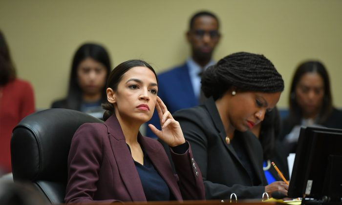 Rep. Alexandria Ocasio-Cortez (D-N.Y.) listens as Michael Cohen, former attorney for President Donald Trump, testifies before the House Oversight and Reform Committee in the Rayburn House Office Building on Capitol Hill on Feb. 27, 2019. (MANDEL NGAN/AFP/Getty Images)