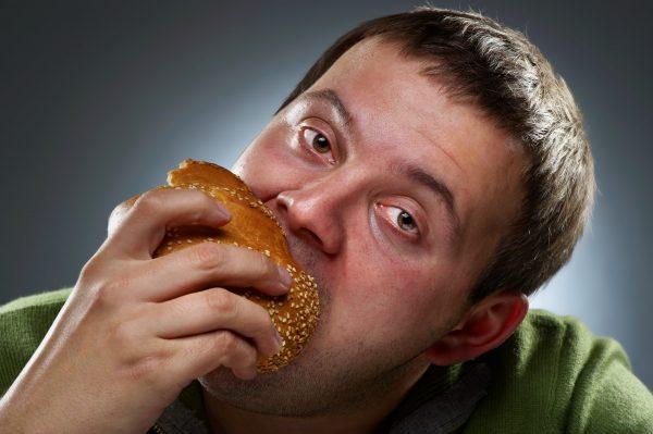 Eating until feeling ill