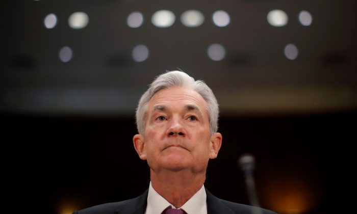 """U.S. Federal Reserve Board Chairman Jerome Powell waits to testify at a Senate Banking and Housing and Urban Affairs Committee hearing on """"The Semiannual Monetary Policy Report to Congress"""" on Capitol Hill in Washington, U.S., February 26, 2019.      (Jim Young/Reuters)"""