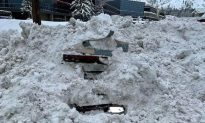 Snowplow Hits Car Buried In Snow Revealing Woman Trapped Inside