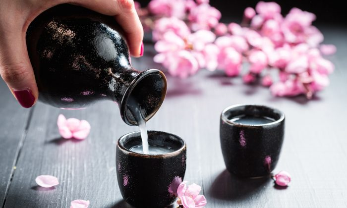 Sake and cherry blossoms. (Shaiith/Shutterstock)