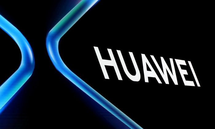 The Huawei logo is displayed ahead of the Mobile World Congress (MWC 19) in Barcelona, Spain on Feb. 24, 2019. (Sergio Perez/Reuters)
