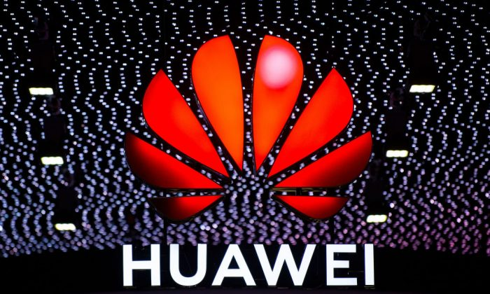 A logo sits illuminated outside the Huawei booth on day 2 of the GSMA Mobile World Congress 2019 in Barcelona, Spain, on Feb. 26, 2019. (David Ramos/Getty Images)