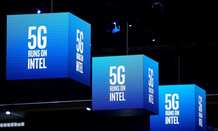 5G signs are displayed at the Intel stand at the Mobile World Congress (MWC) in Barcelona on Feb.  25, 2019. (Josep Lago/AFP/Getty Images)