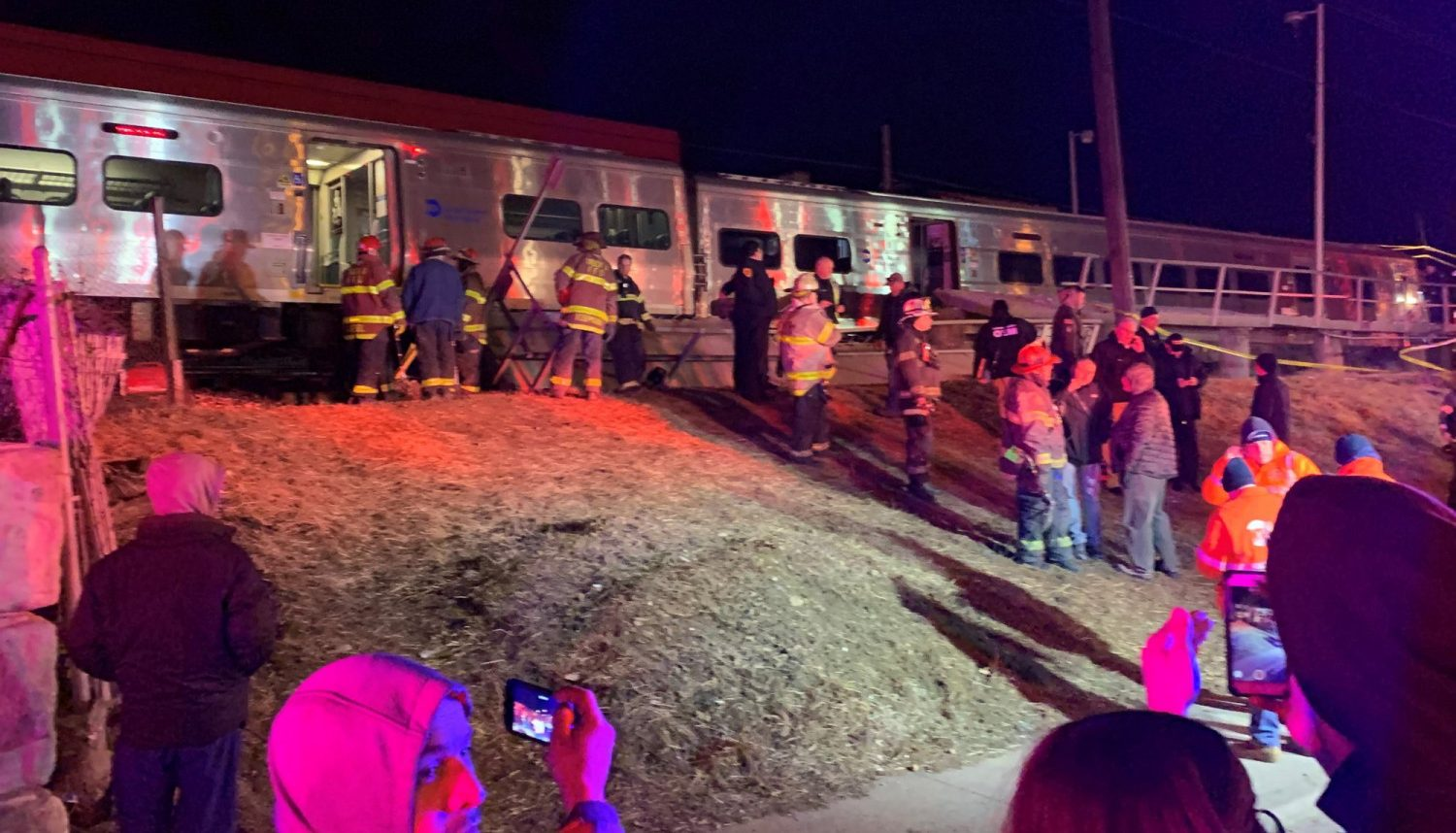 First responders work the scene of a collision involving a Manhattan-bound commuter train and a vehicle