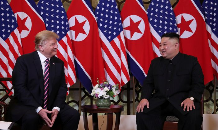 President Donald Trump and North Korean leader Kim Jong Un sit down before their one-on-one chat during the second U.S.-North Korea summit at the Metropole Hotel in Hanoi, Vietnam, on Feb. 27, 2019. (Leah Millis/Reuters)