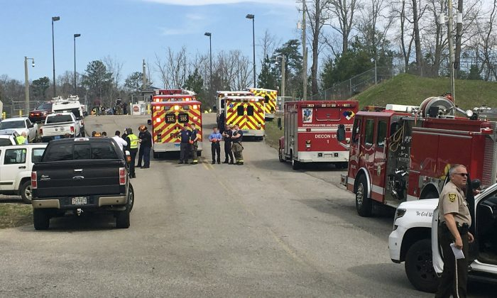 Emergency personnel gather near Birmingham Water Works where a chemical spill sent more than 50 people to the hospital, on Feb. 27, 2019. (Anna Beam/The Birmingham News via AP)