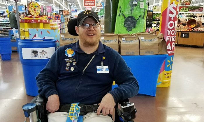Walmart greeter John Combs works at a Walmart store in Vancouver, Wash., on April 21, 2018. (Rachel Wasser via AP)
