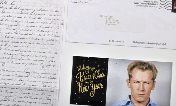 "A hand-written letter by the late mobster James ""Whitey"" Bulger, an envelope and a holiday greeting card emblazoned with his 1959 Alcatraz mugshot, that Bulger mailed from federal prison in Coleman, Fla., in 2015. (Darin Rone/Urban Culture Auctions via AP)"