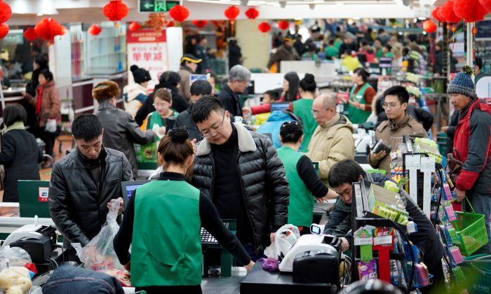 Customers are seen in a supermarket in Beijing, on Feb. 4, 2018. (Jason Lee/Reuters)