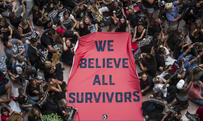 Protestors rally against Supreme Court nominee Judge Brett Kavanaugh in the atrium of the Hart Senate Office Building on Capitol Hill, October 4, 2018 in Washington, DC. Drew Angerer/Getty Images