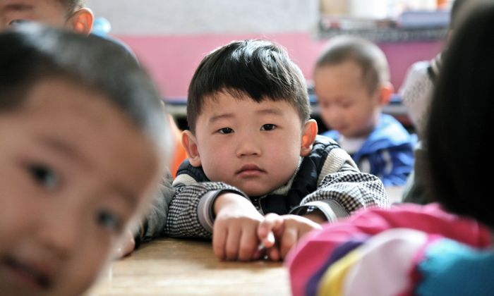 Young Chinese children attend a preschool in Beijing on April 26, 2012. (STR/AFP/Getty Images)